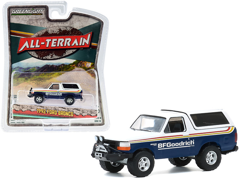 """1992 Ford Bronco with Off?Road Parts """"BFGoodrich Tires"""" Blue and White with Stripes """"All Terrain"""" Series 10 1/64"""